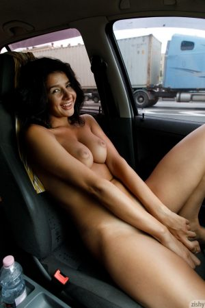 hot naked girl with big tits inside a car