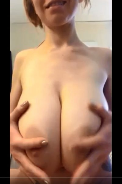 Naked woman playing with her saggy huge natural tits (gif)