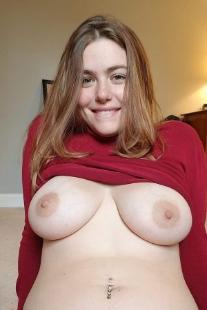 alluring chubby girl flashes her big tits from sweater1