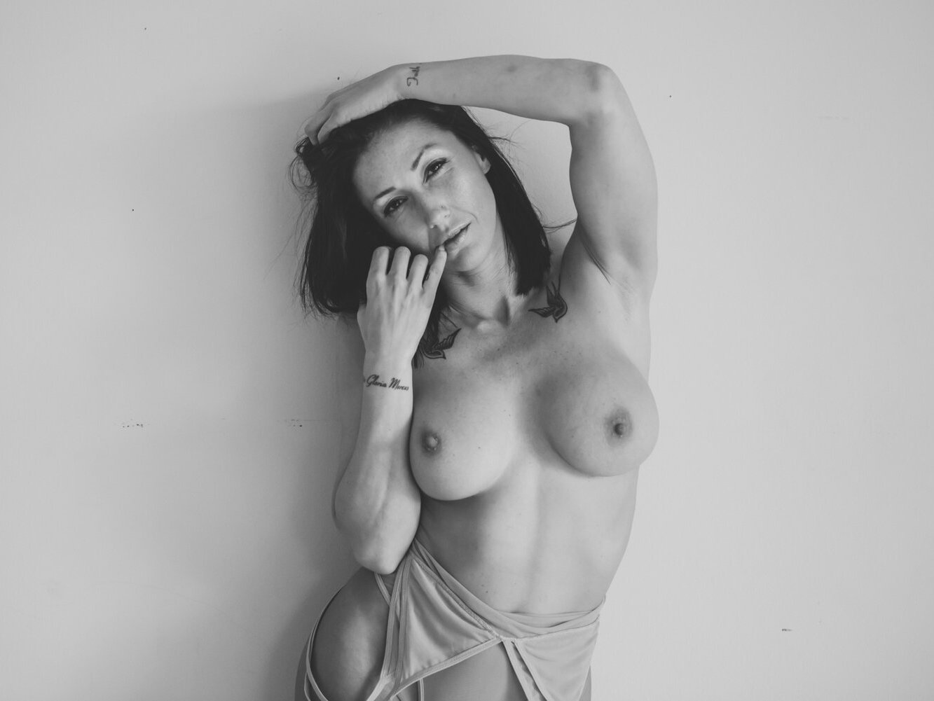 Busty woman nude photography in black and white