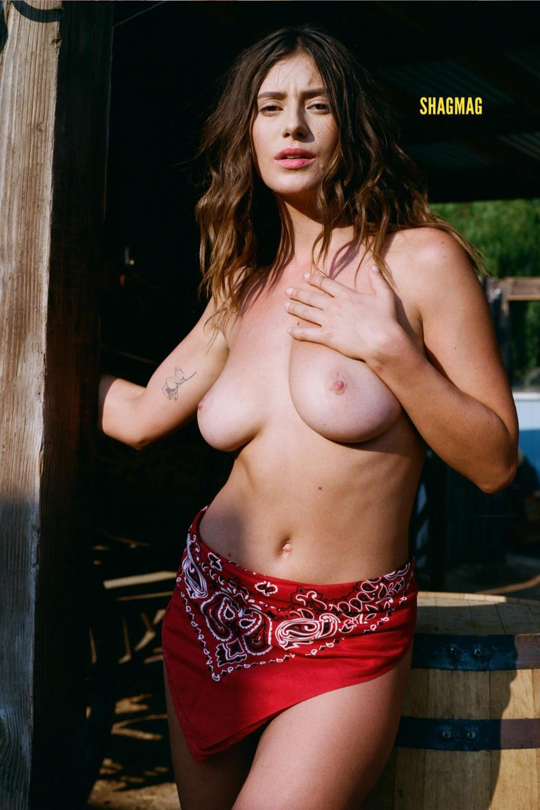 fashion model topless in adult magazine pose 1