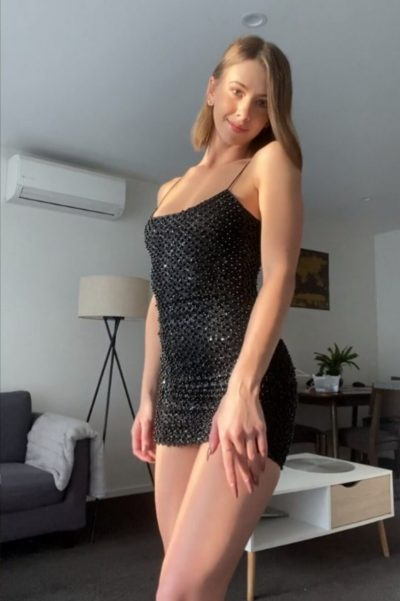 Sweet young lady removing her mini dress (gif)