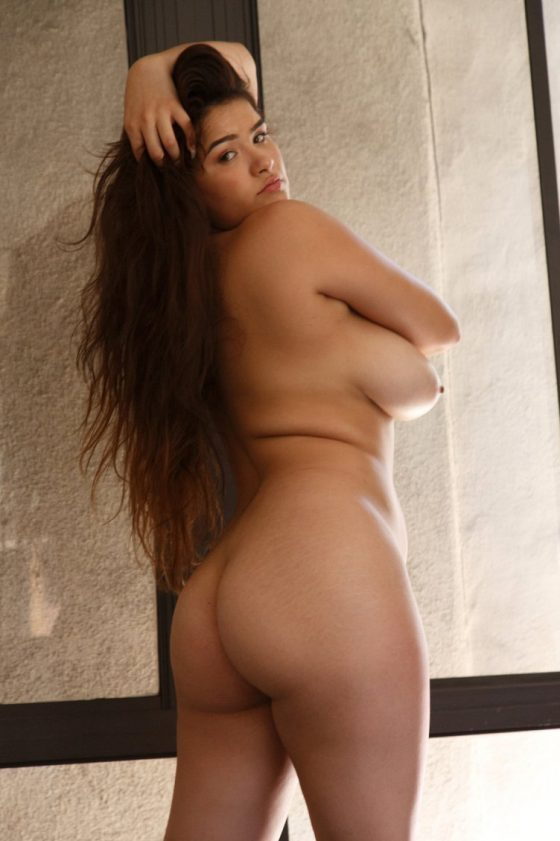Chubby chick getting naked inside