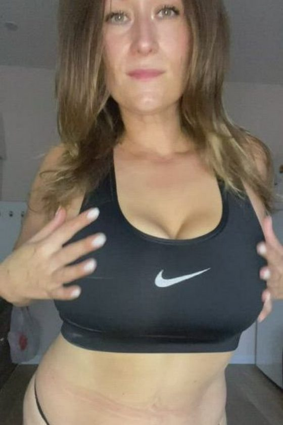 Fitness woman reveals her huge tits (gif)